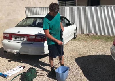 Preparing the car washing mixture as part of the mobile exterior detailing process