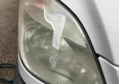 Headlight before cleaning with cleanser- polish applied